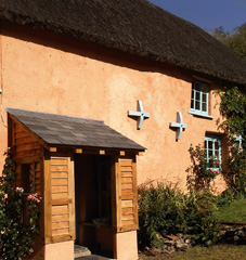 limewashed lime render on traditional thatched Devon cottage