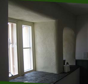 modern and stone mullion windows plastered in rubbed up coarse lime