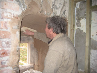 pugging out arched stone mullion window with lime