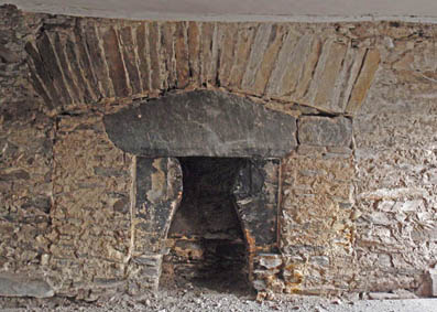 Infilled inglenook showing several fireplace phases