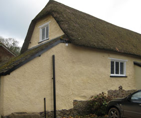 Limewashed thatched cob barn