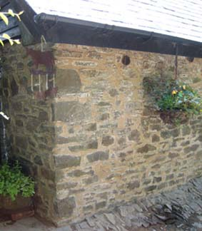 stone wall repointed in lime and mud